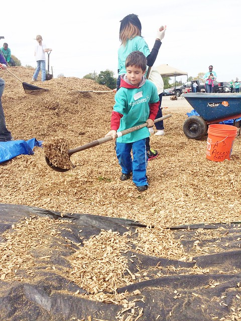 KaBOOM! Community Playground Build moving mulch
