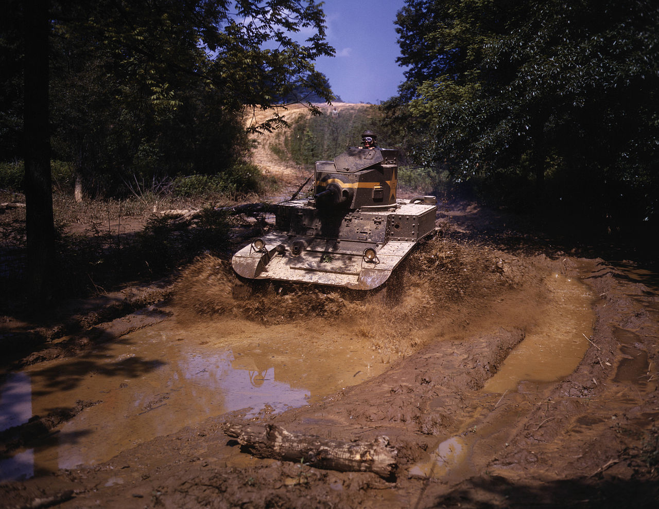 An M3 Stuart light tank going through water obstacle, Ft Knox, KY, 1942