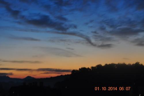 blue sunset red orange black clouds star burst