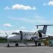 Co-pilot greets passengers in Hamilton