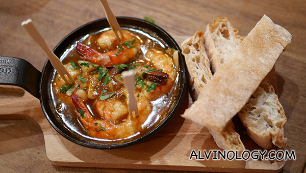 Gambas Picantes - fresh shrimp cooked in a dish of boiling olive oil with garlic, chili and smoked paprika