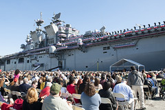 "More than 8,000 friends, family members and guests watch Sailors and Marines man the rails as they ""bring the ship to life"" during the USS America (LHA 6) commissioning ceremony. (U.S. Navy/MC2 Jonathan A. Colon)"
