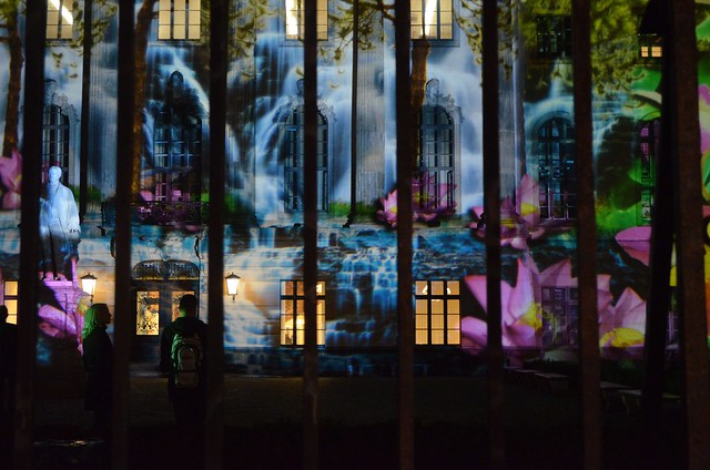 10th Berlin Festival of Lights _Humboldt-Universität waterfall illumination through iron fence