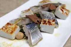 Sgombro marinato e affumicato, insalata di puntarelle, nocciole, polvere díarancio, bottarga di tonno, ricotta infornata
