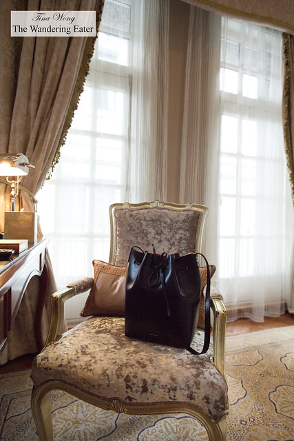 My Mansur Gavriel bag on the plush chair in the King Waldorf Suite