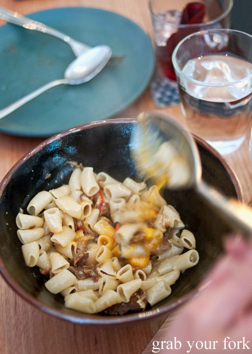 Mixing the egg yolk into the macaroni at ACME, Rushcutters Bay