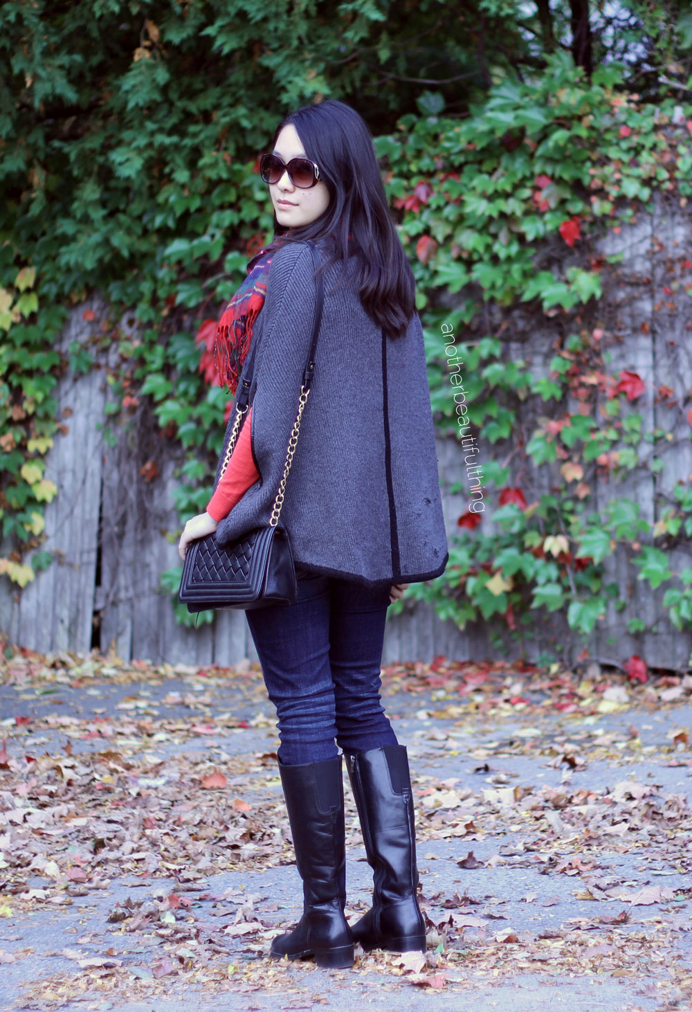 Poncho weather || Black chain crossbody and red plaid scarf