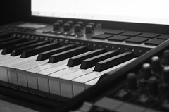 synthesizer, musical keyboard, monochrome photography, electronic musical instrument, electronic keyboard, music workstation, electric piano, digital piano, monochrome, black-and-white, analog synthesizer, electronic instrument,