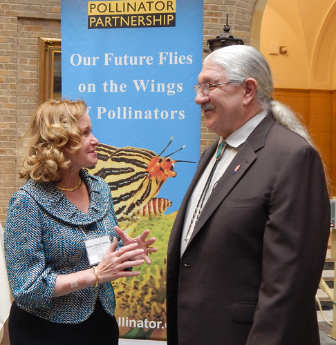 "Laurie Davies Adams, Executive Director of the Pollinator Partnership, with Deputy Under Secretary Arthur ""Butch"" Blazer at a recent North American Pollinator Protection Campaign meeting at USDA headquarters. Photo Credit: Jane Knowlton, U.S. Forest Service"