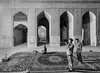 Men pray at Jameh Mosque of Isfahan by damonlynch