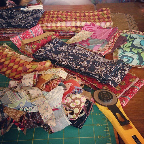 Cutting scraps into strips. So scraps. Many fabric. Ahhh!