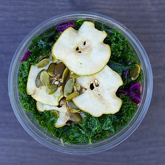 Kale salad with dried pears and smoked paprika pum…