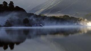 Misty sunrise Padarn lake.