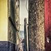 Angostos callejones con vistas al horizonte en el barrio de pescadores de San Cristóbal, en Las Palmas.