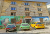 Macedonia, Drama, cars parked infront of a derelict building, Greece #Μacedonia by gentle wolf