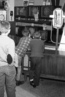 Boys viewing televisions on display while Christmas shopping at Sears, Roebuck and Co. in Tallahassee