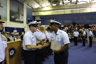 Master Chief Petty Officer of the Coast Guard Steven W. Cantrell shakes hands with a recent graduate of Coast Guard recruit company Juliet 190, Oct. 24, 2014, at U.S. Coast Guard Training Center Cape May, N.J. Cantrell is currently serving as the 12th MCPOCG of the Coast Guard. (U.S. Coast Guard photo by Chief Petty Officer Kyle Niemi)