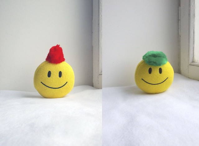 Smiley face green and red hats