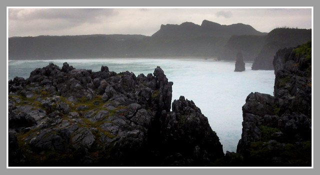 TYPHOON WEATHER AT HEDO POINT -- Looking South Through a Karst Fissure Over Uza Bay to the Karst Peaks
