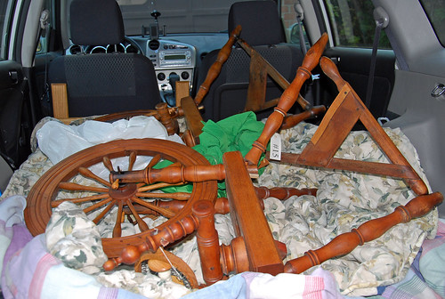 Antique saxony spinning wheels in a hatchback vehicle