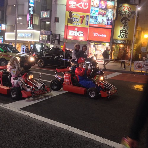 At Shibuya crossing, we saw people dressed as Mario characters driving go-karts.