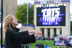 Dr. Mallory Thompson Conducts the University Hymn ::  	   The Northwestern University 'Wildcat' Marching Band performs at Ryan Field as Northwestern Football hosts Wisconsin on October 4, 2014.  Photo by Daniel M. Reck '08 MSEd.