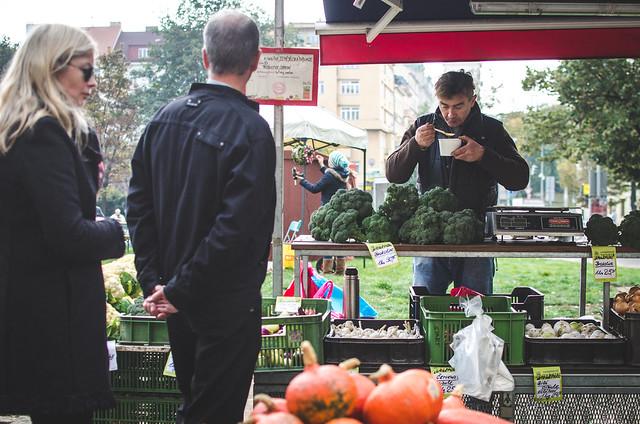 A vendor at Náměstí Jiřího z Poděbrad, or Jiřák in Prague takes a lunch break.