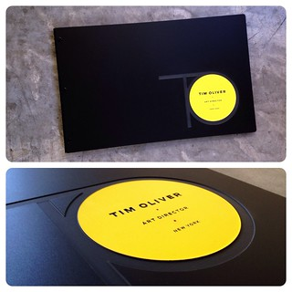Custom art director portfolio book in matte black acrylic with engraved color fill treatment