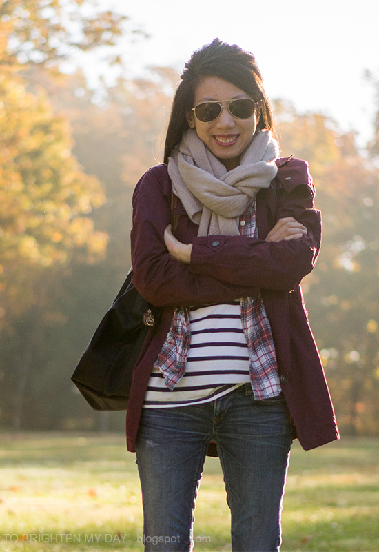 taupe chunky scarf, dark red jacket, plaid shirt, striped tee