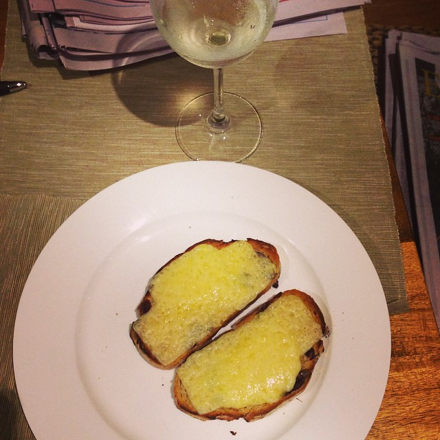 Sunday night dinner. Cheese on toast, glass of vino, reading the weekend papers #happy