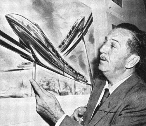 Walt Disney reviewing concept art for the Disneyland Alweg Monorail