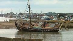 Fishing Bawley 'Alpha', slowly being restored, behind is the River Blythe & Southwold Harbour. Walberswick, Suffolk. 11 10 2014