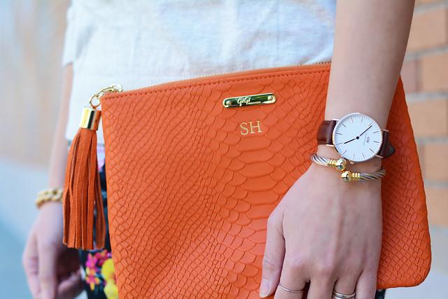 Daniel Wellington St Andrew watch, GiGi New York orange clutch