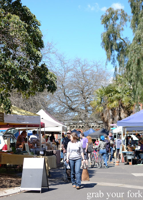 Shoppers and stalls at Abbotsford Convent Slow Food Farmers Market
