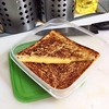 Grilled Cheese Sandwich  Use two slices of cheddar or American cheese. Smother each side of the bread with a generous amount of butter. Grill on a non-stick pan until golden brown. Variations include adding a slice of cooked ham, Lyoner or Bologna. Slice