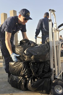 Petty Officer 2nd Class Parker C. Hofmann, a crewmember aboard the Coast Guard Cutter Alligator, conducts a drug offload at Coast Guard Sector St. Petersburg, Fla., Nov. 13, 2014. The Alligator's crew performs drug interdictions in support of the Coast Guard's law enforcement mission. (U.S. Coast Guard photo by Seaman Meredith A. Manning)