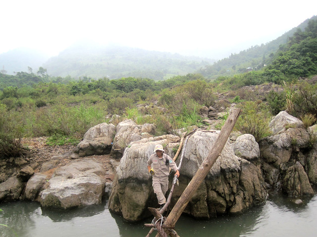 Pic of the Day: Carrying UXO across a temporary suspension bridge