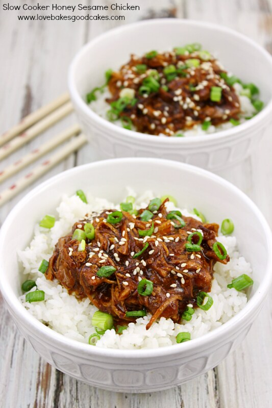Slow Cooker Honey Sesame Chicken in two white bowls.