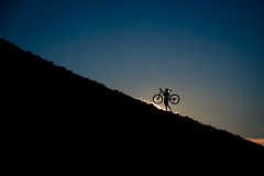 Silhouette carrying a bike