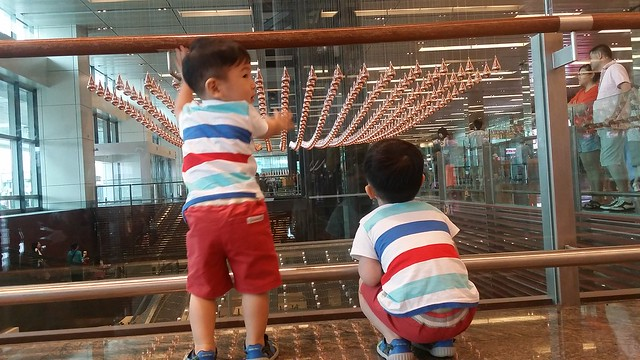 Boys amazed by the Kinetic Rain Art Display in Changi Airport Terminal 1