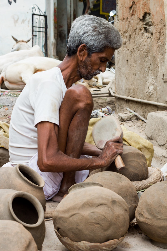 man making clay pots