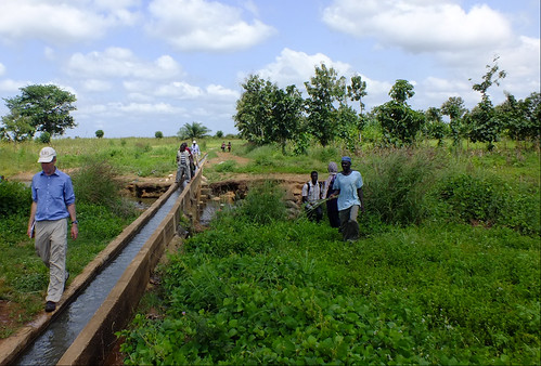 Alan Duncan visiting irrigation waterway at Golinga, Northern Ghana  to see possibilities for ILSSI's irrigated fodder project