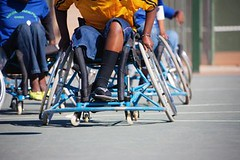 endurance sports(0.0), road cycling(0.0), cycling(0.0), bicycle(0.0), wheelchair(1.0), vehicle(1.0), sports(1.0), wheelchair racing(1.0),