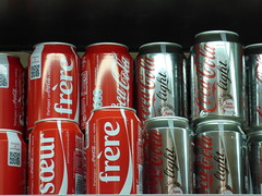aluminum can(1.0), soft drink(1.0), red(1.0), carbonated soft drinks(1.0), tin can(1.0), drink(1.0), cola(1.0), coca-cola(1.0),