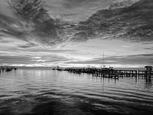 sky blackandwhite bw usa cloud building water sunrise river landscape ir dawn dock unitedstates florida cloudy infrared titusville centralflorida edrosack