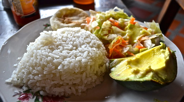 sancocho de gallina with rice and avocado