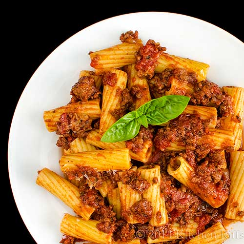 Italian Meat Sauce with pasta on plate, overhead view