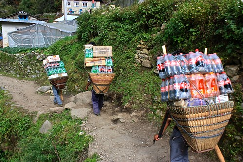 Porters pack up soda for peak season. The delivery charge is included in the cost of your food