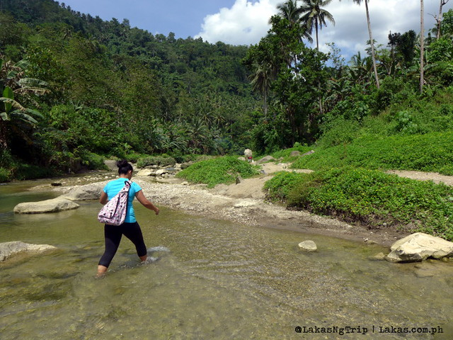 Another river crossing on the same river. River trek to Dodiongan Falls. Iligan City, Lanao del Norte, Philippines