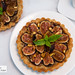 Pistachio and fig tart - pistachio pâte brisÃ:copyright:e, pistachio-orange frangipane, California black mission figs glazed with black pepper honey